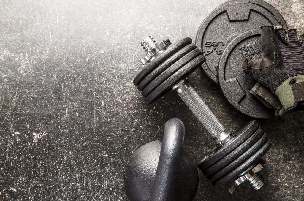 barbells and gym gloves