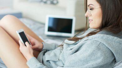girl in bed sending nsfw snapchat in hoodie