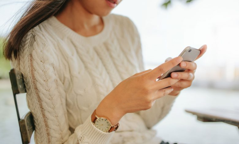 girl in white sweater sending snapchat fuck message