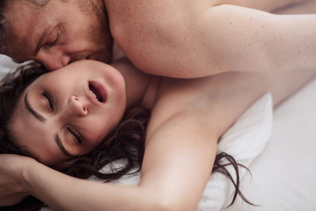 wellhello members being passionate and having sex on bed